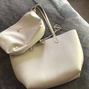 BCBG purse with detachable clutch included